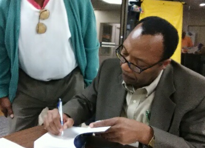 Author Ardain Isma at a book signing in Palm Coast